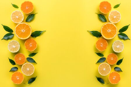 Creative background with tropical fruits. Orange, lemon, lime, grapefruit on a yellow background. Flat lay top view copy space. Nutrition Concept, Vitamin C, Disease Prevention, Flu Standard-Bild - 134039525