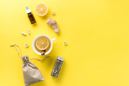Illness concept. Composition alternative medicine. Herbal tea, ginger and lemon on a yellow background. Flat lay. View from above. Copy space Standard-Bild - 134039526