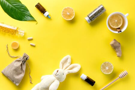 Illness concept. Composition alternative medicine. Herbal tea, ginger and lemon on a yellow background. Childs health. Flat lay. View from above. Copy space Standard-Bild - 134039527