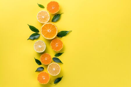 Creative background with tropical fruits. Orange, lemon, lime, grapefruit on a yellow background. Flat lay top view copy space. Nutrition Concept, Vitamin C, Disease Prevention, Flu Standard-Bild - 134039539