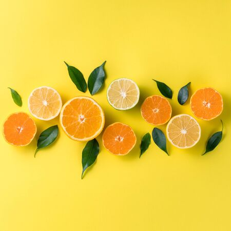 Creative background with tropical fruits. Orange, lemon, lime, grapefruit on a yellow background. Flat lay top view copy space. Nutrition Concept, Vitamin C, Disease Prevention, Flu Standard-Bild - 134039587
