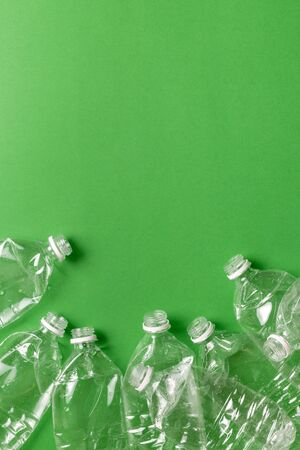 Composition of plastic waste pollution. Sorting and recycling. Disposable plastic bottles for water. Ecological concept. Flat lay, top view, copy space. Standard-Bild - 134039593