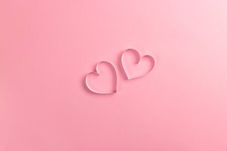 Composition for Valentines Day February 14th. Delicate pink background and pink hearts cut out of paper. Greeting card. Flat lay, top view, copy space. Standard-Bild - 134039745