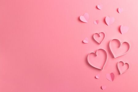 Composition for Valentines Day February 14th. Delicate pink background and pink hearts cut out of paper. Greeting card. Flat lay, top view, copy space. Standard-Bild - 134039748