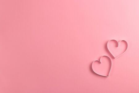Composition for Valentines Day February 14th. Delicate pink background and pink hearts cut out of paper. Greeting card. Flat lay, top view, copy space. Standard-Bild - 134039763