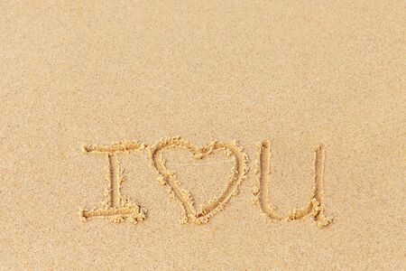 Valentines day on a sunny beach. Text I love you. Declaration of love painted on the sand. Love concept. Relax on the sandy beach. Copy space. Standard-Bild - 134278793