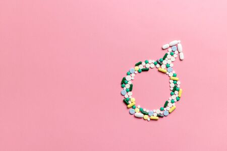Mens health concept. Male hormones testosterone. Molecular chemical formulas on a pink background. Gender symbol made of pills on a pink background. Male sign.