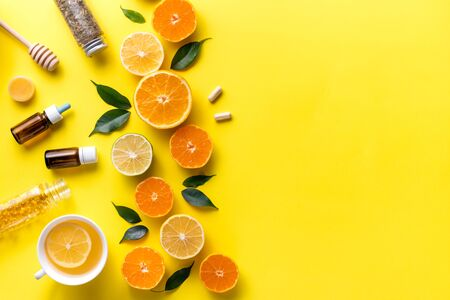 Composition with tropical fruits. Orange, lemon, lime, grapefruit on a yellow background. Flat lay top view copy space. Nutrition Concept, Vitamin C, Disease Prevention, Flu