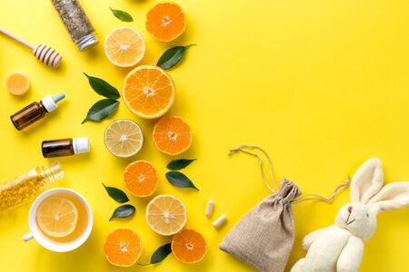 Illness concept. Composition alternative medicine. Herbal tea, ginger and lemon on a yellow background. Child's health. Flat lay. View from above. Copy space. Banco de Imagens