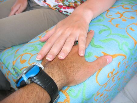 sunburned: Hands of two persons in love