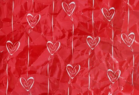 creased: Ten hearts and arrows on creased red paper Stock Photo