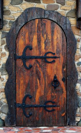 view of a wooden doorway: Old wooden door. Old-fashioned pub doorway