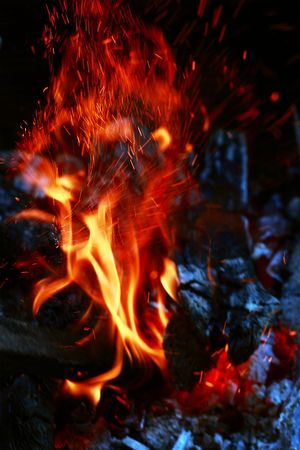 Strange fire. Sparky flame and black ash abstract background photo