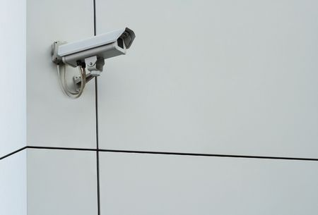 Security camera. Digital camcorder on gray plastic facade wall Stock Photo - 5185311