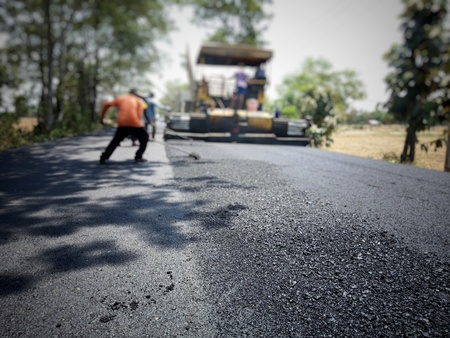 Asphalt road construction in Thailand, blurred images