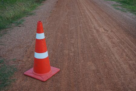 Red rubber cone placed on the road to ensure safety 写真素材