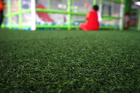 Artificial turf in the playground, blurred background Stockfoto - 128618450