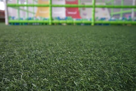 Artificial turf in the playground, blurred background Banque d'images - 128902856