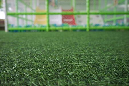 Artificial turf in the playground, blurred background