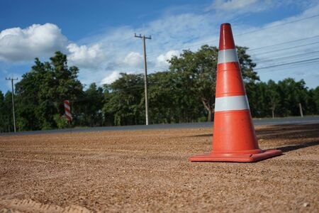 Red rubber cone is placed on the road during the construction of the road. Banque d'images - 132015380