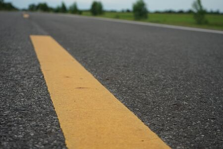Road traffic paint on the asphalt surface And to ensure safety Stock Photo