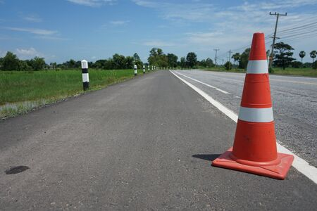 Red rubber cone placed on the road to ensure safety