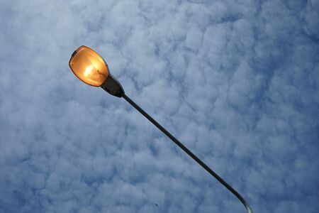 Electric light during the day, with a backdrop of clouds Banque d'images - 132015028
