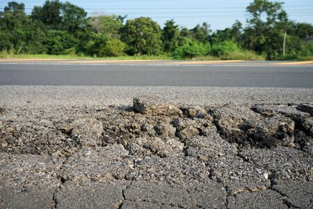 Damaged roads, potholes Must have urgent surface repair With the method of digging, repairing, and covering it with asphalt Standard-Bild - 133691494