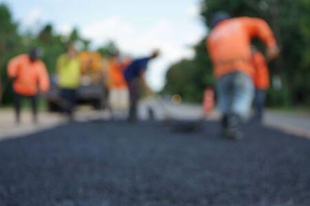 Repairing a damaged road By adjusting the level with asphalt mixed with small stones And then compacted with a vibratory compactor