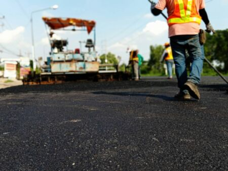 Picture blurred asphalt road construction By using heavy machinery