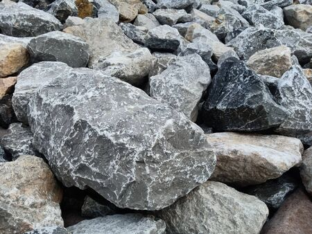 Large stones are used in construction to prevent water erosion. Riverbank