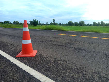 road construction with a red rubber cone in front in thailand Archivio Fotografico