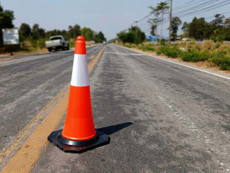 Road construction blur And the rubber cone is located in front For safety 免版税图像