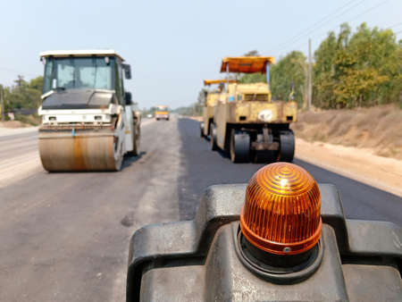The image is blurred in the construction of paved roads. By heavy machinery