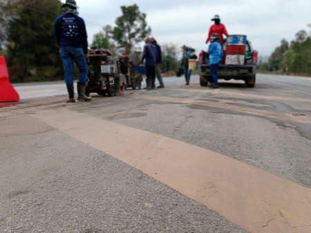 Blur the work of cutting-drilling the road for island construction. 免版税图像
