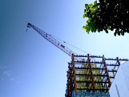 construction working site with cloudy blue sky