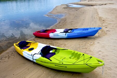 colorful boats on beach along river photo
