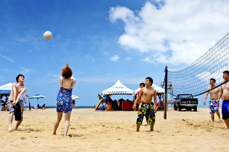 a group of people playing Beach volleyball on beach on May 31, 2011 in Fulong, Taiwan Stock Photo - 9656940