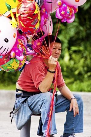 dilate: Taipei-May 24:a man sales balloons on May 18 ,2011 in Taiwan