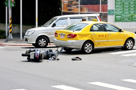 Taipei,Taiwan-July 4 a car accident that a motorbike hit a taxi in Taipei city,2011 in Taipei,Taiwan Stock Photo - 9890687