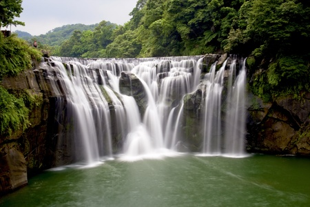 a majestically beautiful waterfall in Taiwan