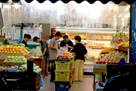people shopping in the fruit shop