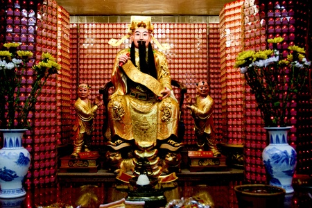 a statue of a chinese god in a temple in taipei