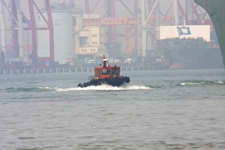 New Taipei City,Taiwan-September 29:a Taiwan work ship at Keelung port working for clean the ocean on September 29,2011 in Keelung,Taiwan Stock Photo - 10739043