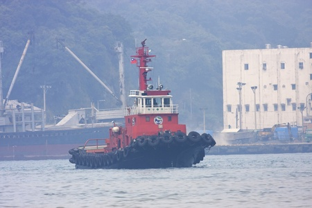 New Taipei City,Taiwan-September 29:a Taiwan work ship at Keelung port working for clean the ocean on September 29,2011 in Keelung,Taiwan Stock Photo - 10739044