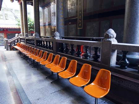 orange outdoor seats in an ancient temple photo