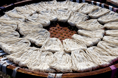 detail view of noodles under fabricate on sunbath at Guan Temple in Tainan,2011 in Taiwan photo