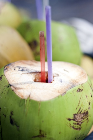 delicious coconut juice with sucker photo