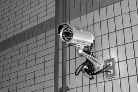 city surveillance: Security camera in the public place of buildings Stock Photo