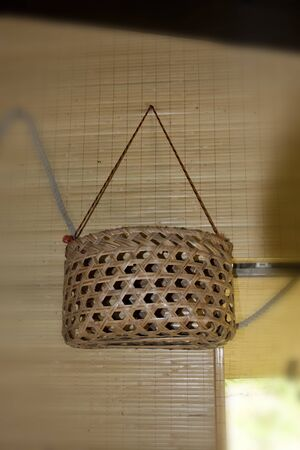 Bamboo basket as a handicraft display in public house photo